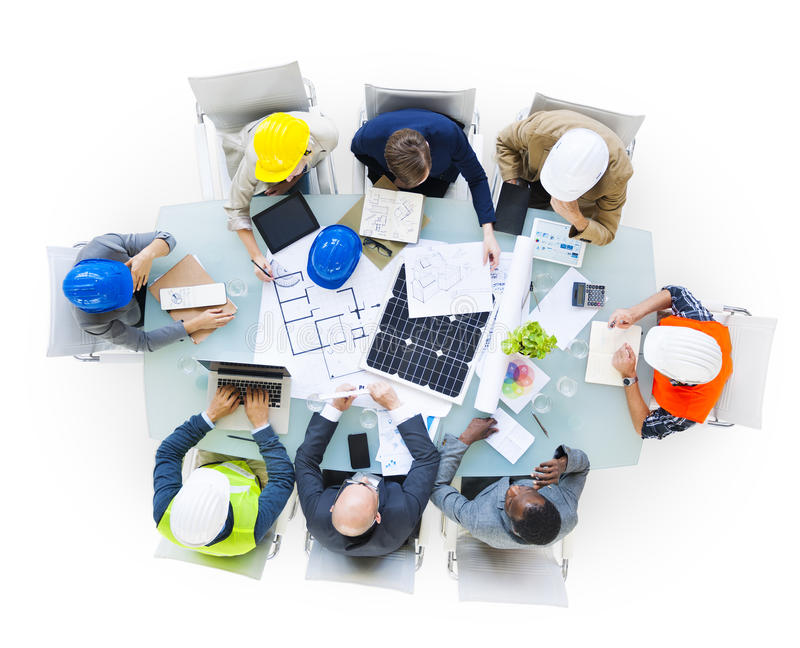 Construction Site Workers on Conference Table royalty free stock images