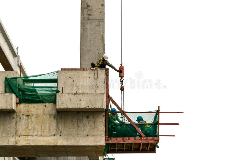 Construction site workers. With scaffold royalty free stock photography