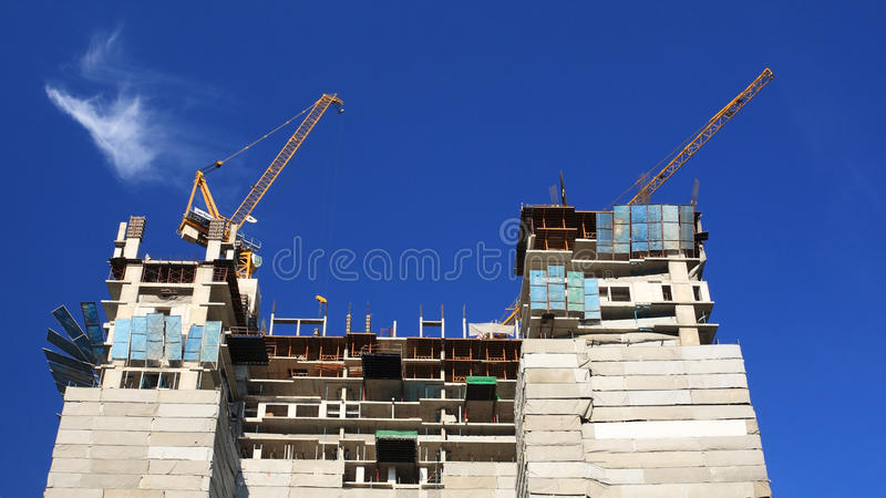 Construction site with yellow cranes royalty free stock photography