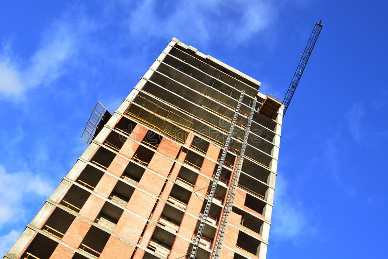 Construction of a skyscraper monolith royalty free stock photo