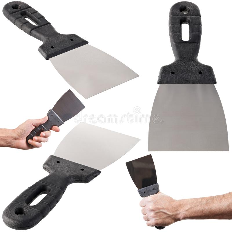 Construction spatula in hand isolated on white background.  stock photography