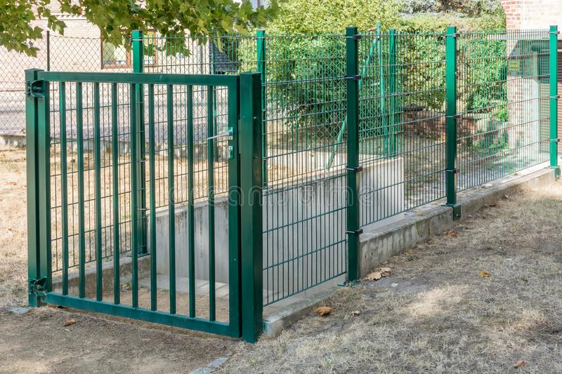 Construction of a stable garden fence made of metal stock images