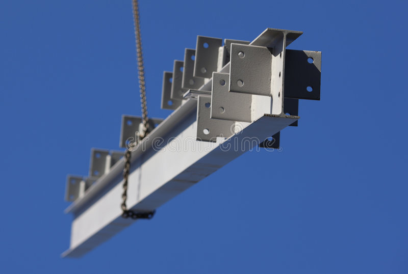 Construction Steel Girder. Structural steel member being lifted by a crane on a construction site stock photo