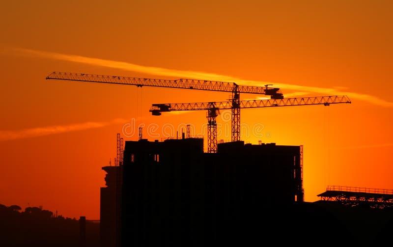 Construction on sunset royalty free stock photo