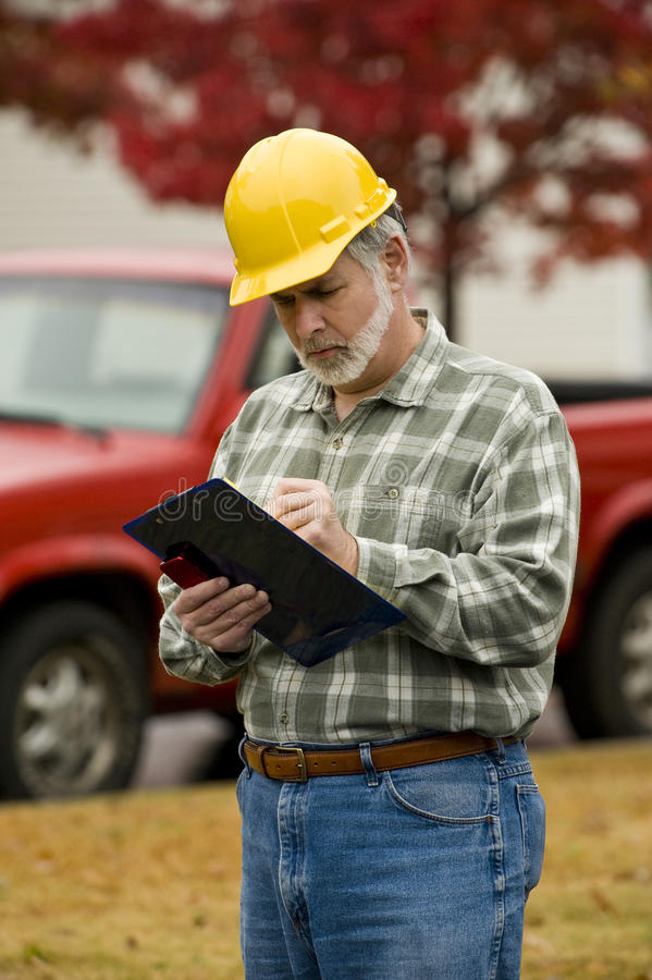 Construction Supervisor With Clipboard royalty free stock images