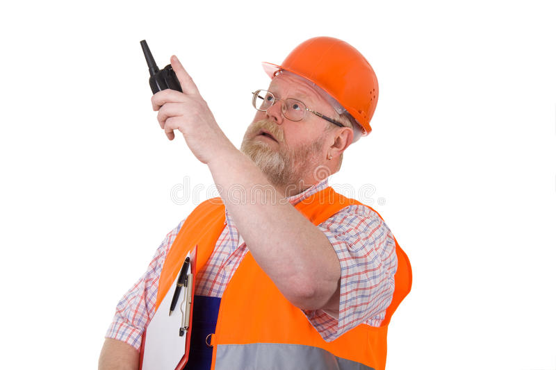 Construction supervisor with walkie talkie stock image