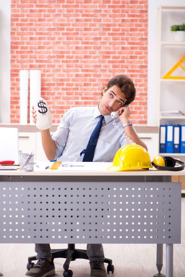 The construction supervisor working on blueprints stock photos