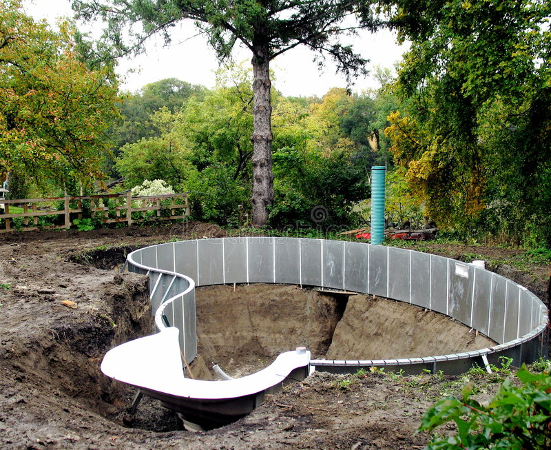 Construction of swimming pool stock image image of for Building a swimming pool in garden