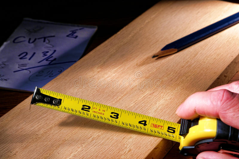 Construction Tape Measure in Carpenter Hand