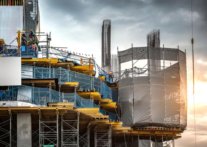 Workers are working on a large building construction industry site. royalty free stock photos