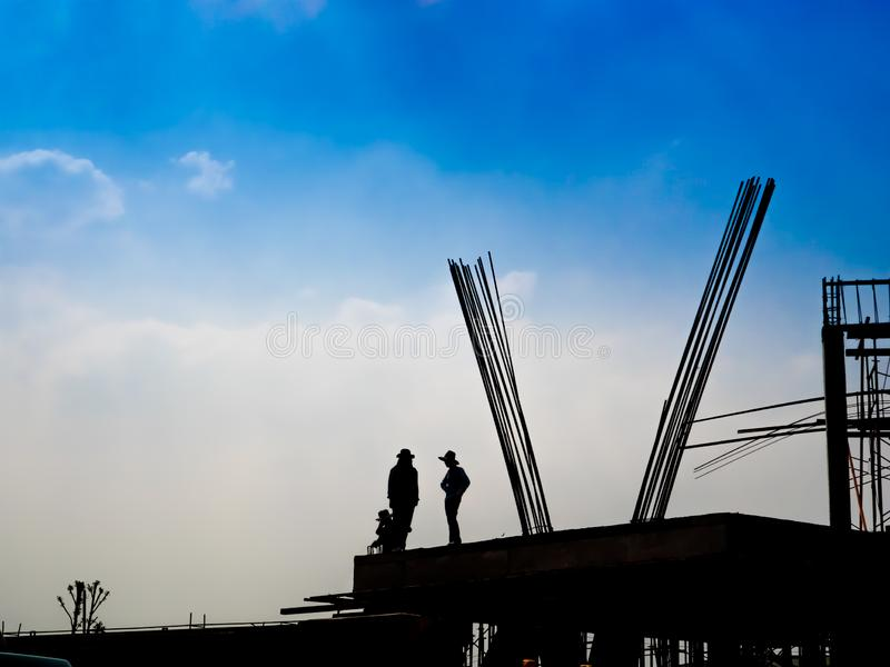 Silhouette of construction workers. royalty free stock image