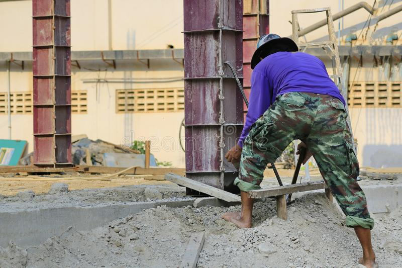 The construction technician is working on the casting of concrete pillars.  stock image