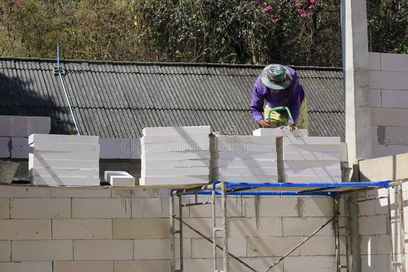 Construction technicians are building brick walls with lightweight bricks.  stock image