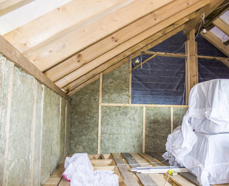 Construction - thermally insulating eco-wood frame house with wood fiber plates and heat-isolating natural hemp material. Finishing the walls with a white stock images