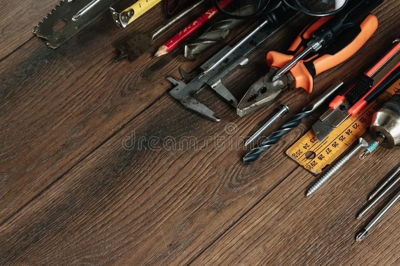 A construction tool on a brown wooden background. View from above. Picture background, screensaver. The concept of construction, royalty free stock photo