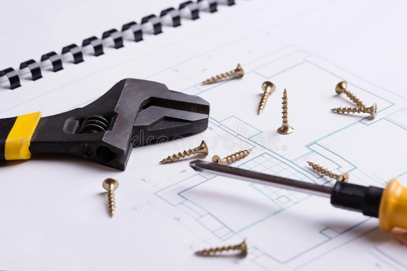 Adjustable wrench, screws and screwdriver close-up royalty free stock images