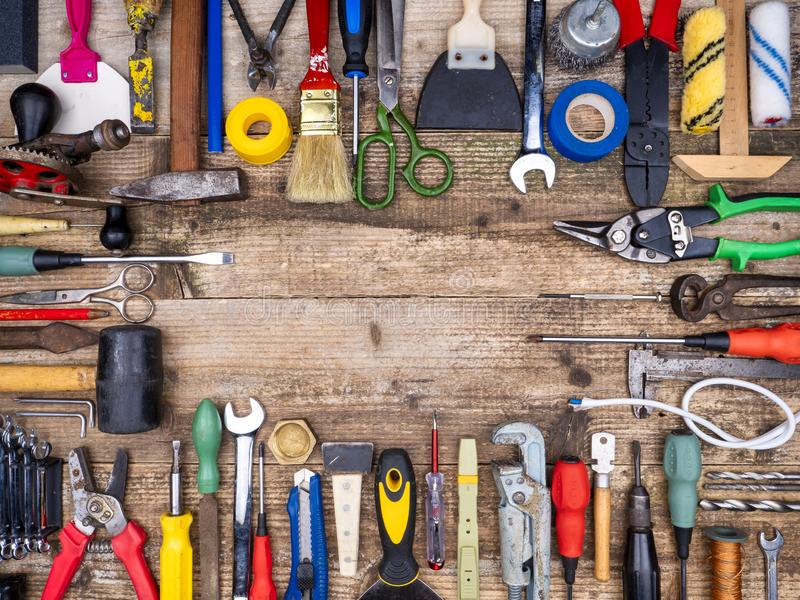 Construction tool on a wooden background royalty free stock images