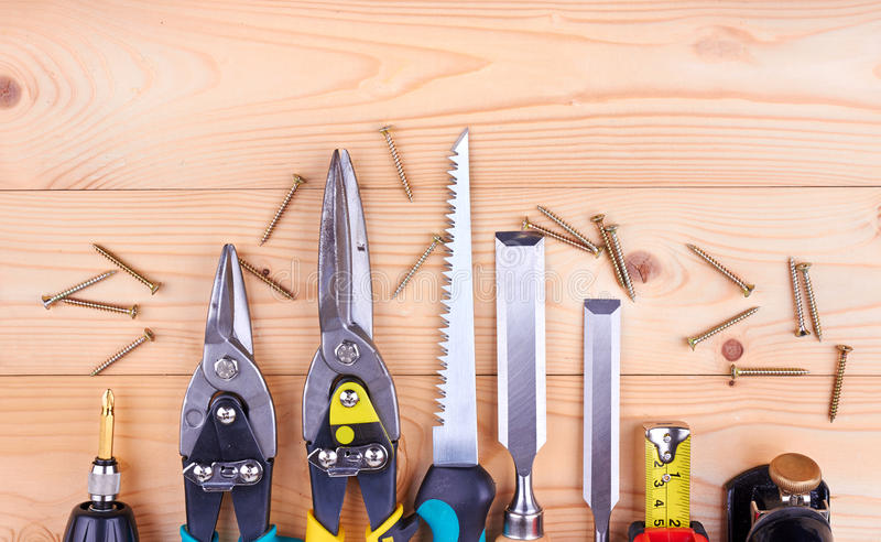 Construction tools. Collage on wooden background stock image