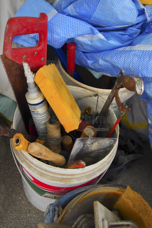 Plastic cement buckets with other construction tools royalty free stock photos