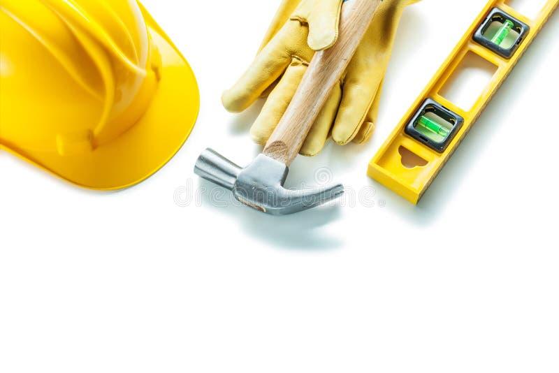Construction tools isolated on white level hammer gloves helmet stock photos