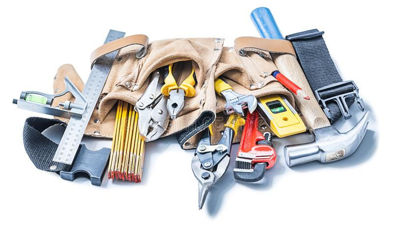 Construction tools in leather toolbelt isolated on white royalty free stock photos