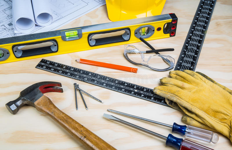 Construction tools randomly placed. On a wooden background royalty free stock images