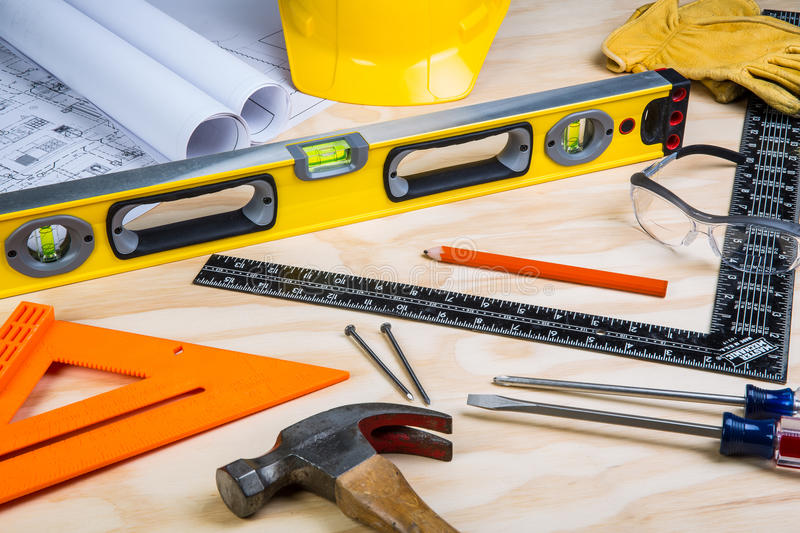Construction tools randomly placed. On a wooden background stock images