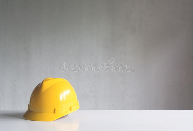 Construction tools or safety equipment with yellow helmet on tab. Le stock image
