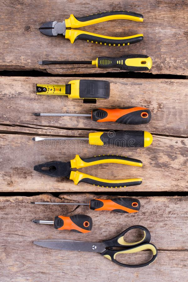 Construction tools set on old wooden background. royalty free stock photos