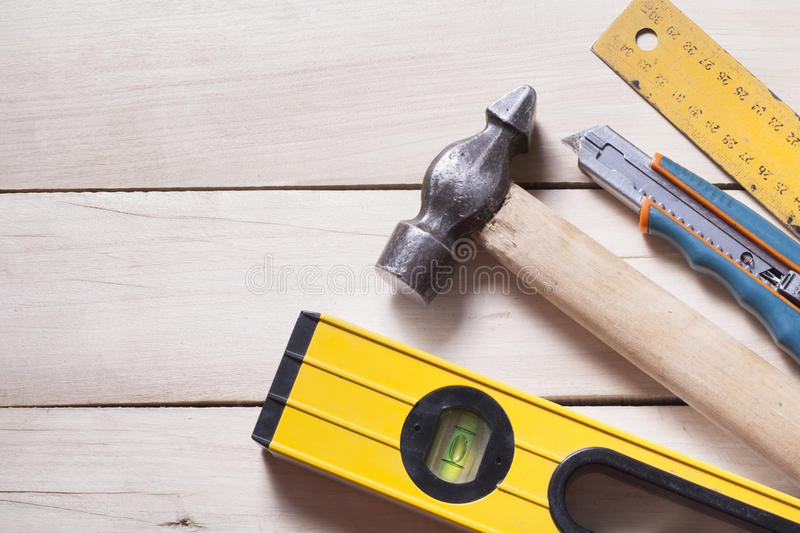 Construction tools on wooden background. Copy space for text. Set of assorted work tools. Top view stock image