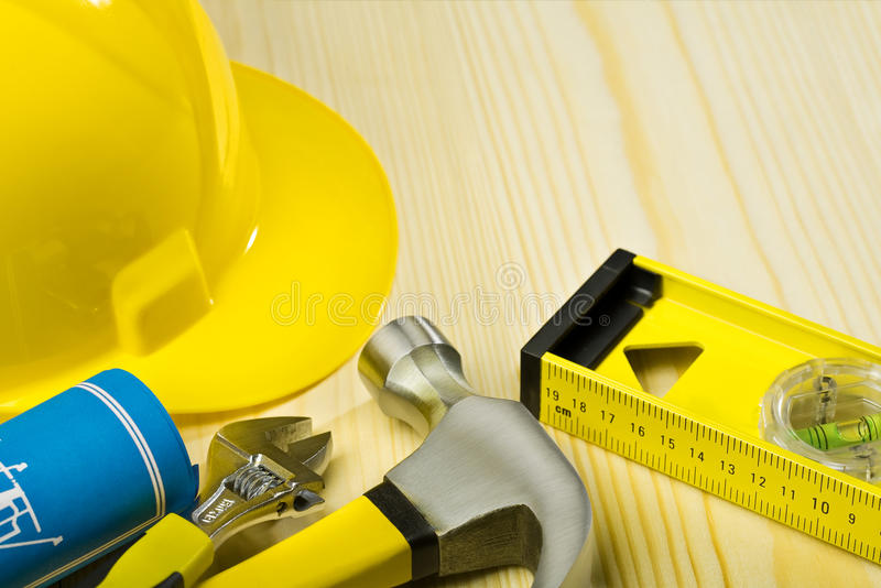 Construction tools on wooden boards stock photo
