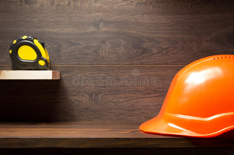 Construction tools at wooden shelf stock photography