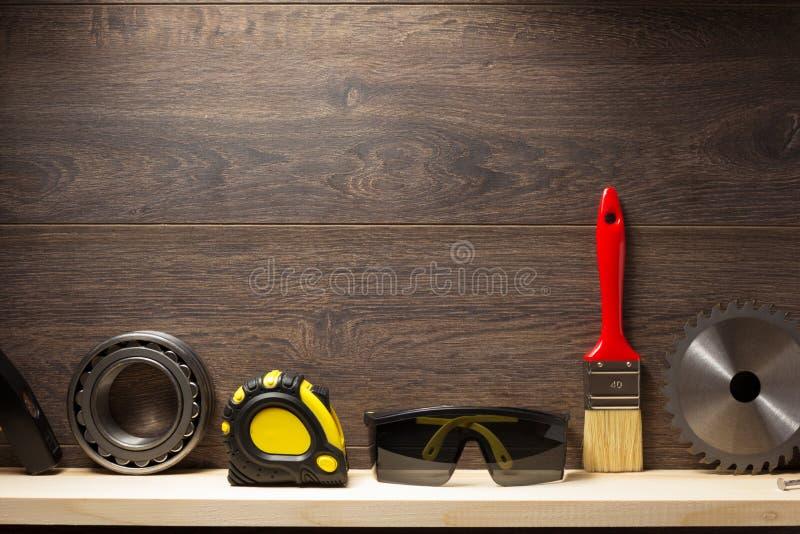 Construction tools at wooden shelf royalty free stock photos