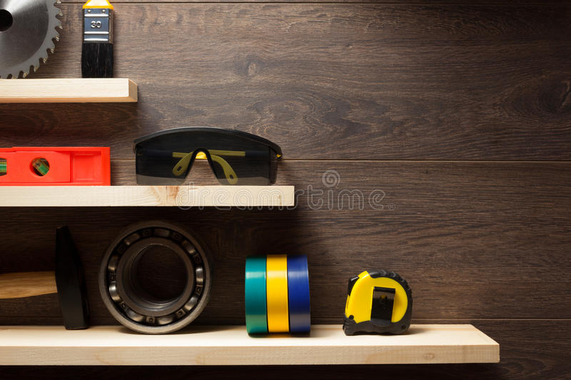 Construction tools at wooden shelf stock photo