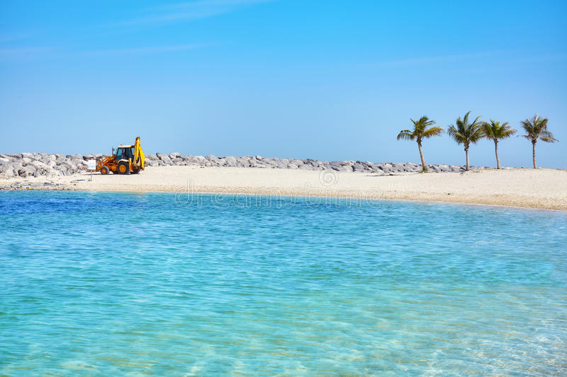 Construction tractor by a breakwater in Dubai, UAE. stock image