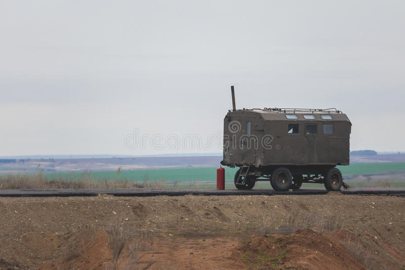 Construction Trailer on road construction work - industrial equipment among fields stock images