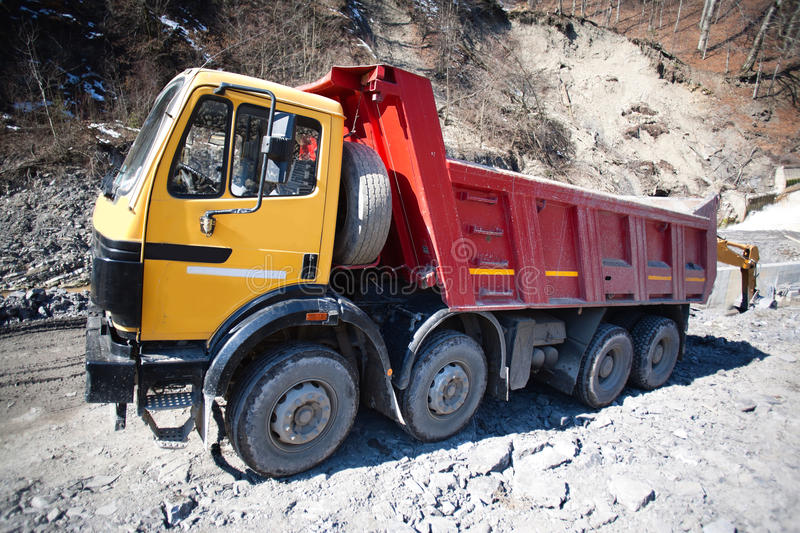Construction truck. Construction heavy truck on a site stock photos