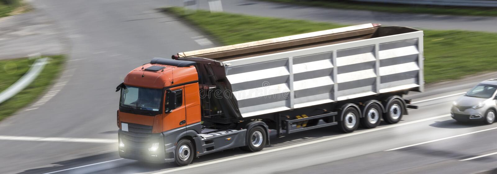 Construction truck speeding on a highway. A construction truck speeding on a highway royalty free stock images