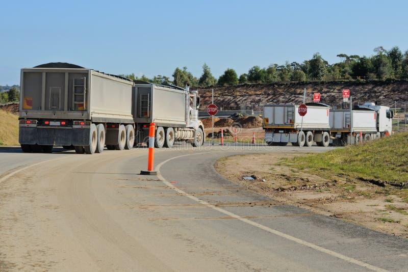 Construction Trucks At Turn Stock Photography