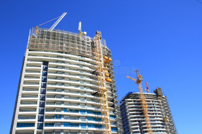 Construction of two high-rise buildings. Building construction process of two high-rise buildings with modern cranes (in Sydneys district Rhodes, Australia royalty free stock photography
