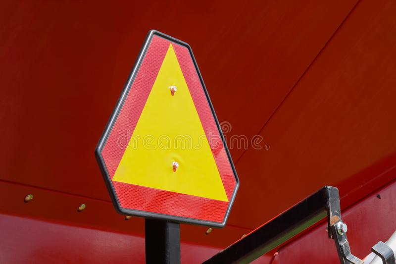 Construction warning sign on blur traffic road on red metal background stock images