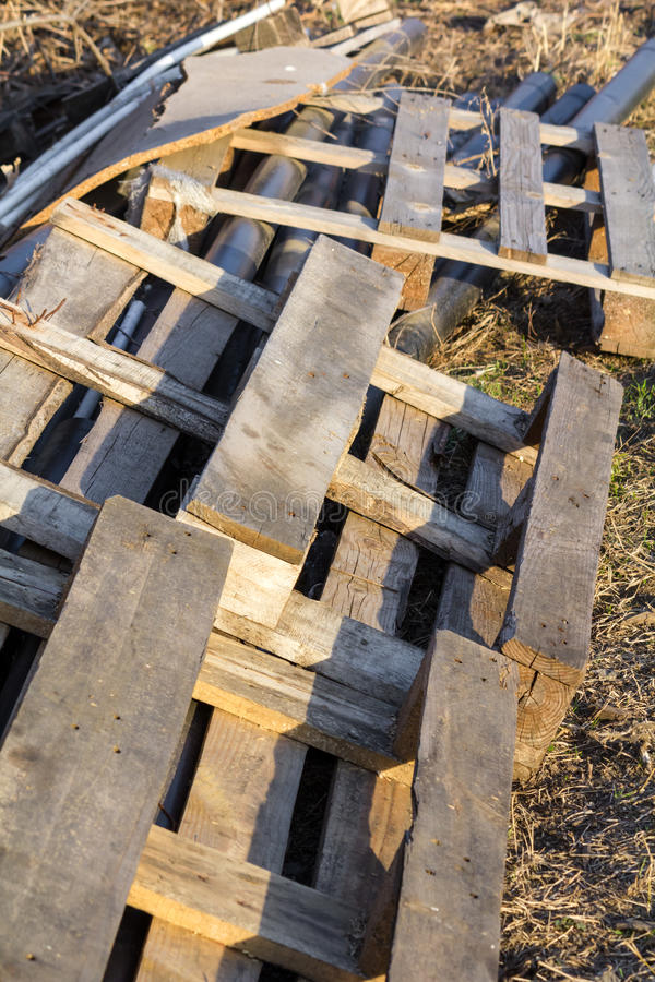 Construction waste. Wooden pallets,tubing,waste from construction materials stock image