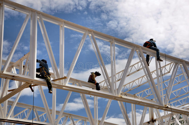 Construction welding workers. Three construction welders working high at a structure
