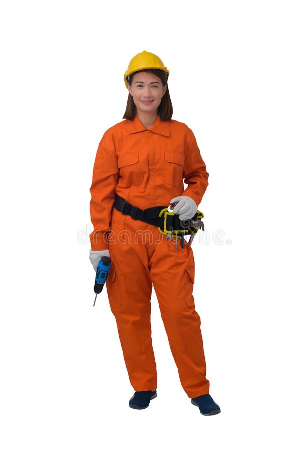 Construction workers wearing Orange Protective clothes, helmet hand holding electric drill with tool belt isolated on white. Construction woman workers wearing royalty free stock photography