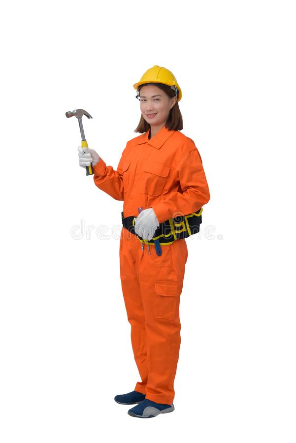 Construction workers wearing Orange Protective clothes, helmet hand holding hammer with tool belt isolated on white backround. Construction woman workers wearing royalty free stock photos