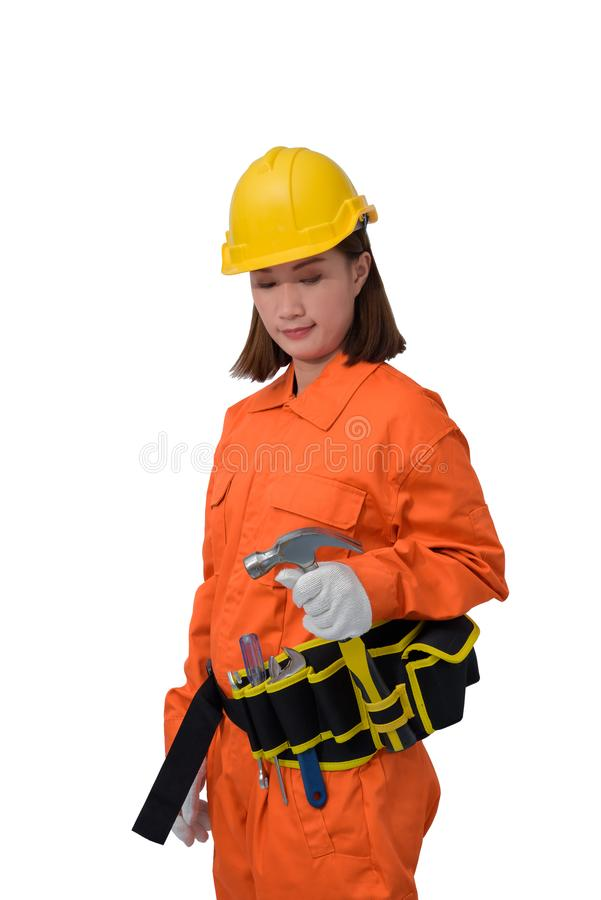 Construction workers wearing Orange Protective clothes, helmet hand holding hammer with tool belt isolated on white backround. Construction woman workers wearing stock photo