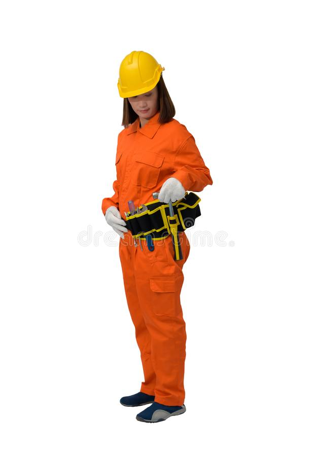 Construction workers wearing Orange Protective clothes, helmet hand holding hammer with tool belt isolated on white backround. Construction woman workers wearing stock photography