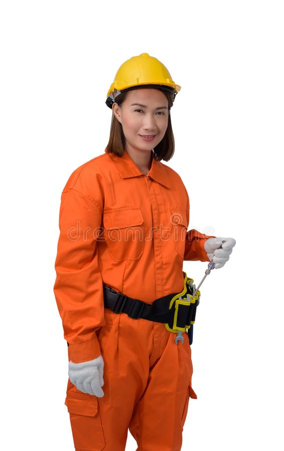 Construction workers wearing Orange Protective clothes, helmet hand holding screwdriver with tool belt isolated on white backround. Construction woman workers stock image