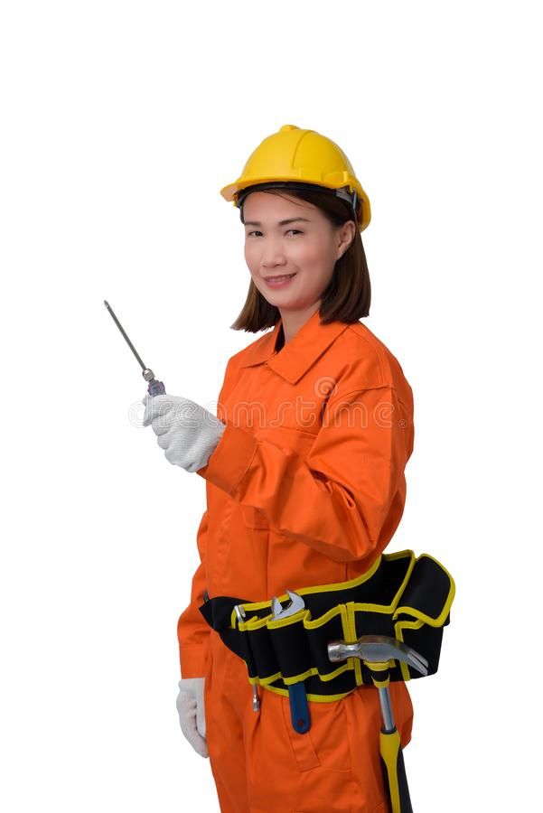 Construction workers wearing Orange Protective clothes, helmet hand holding screwdriver with tool belt isolated on white backround. Construction woman workers royalty free stock photo