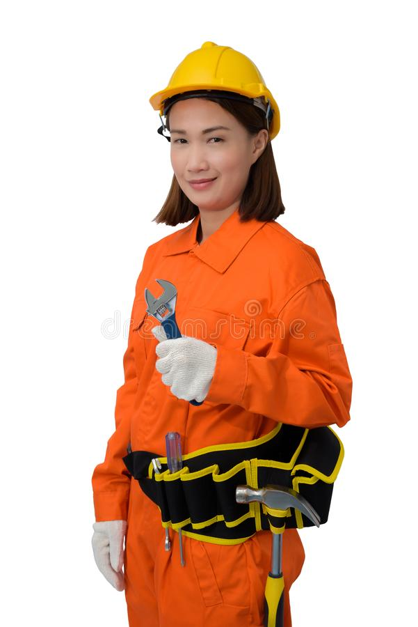 Construction workers wearing Orange Protective clothes, helmet hand holding wrench with tool belt isolated on white backround. Construction woman workers wearing royalty free stock images